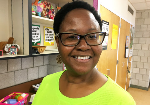 """Math and special education teacher Tracey Pratt – a seminar co-leader – recommends some reading: """"The New Jim Crow: Mass Incarceration in the Age of Color- blindness,"""" by Michelle Alexander."""