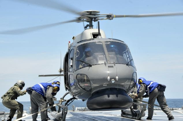 A Royal Malaysian Navy Fennec helicopter prepares to depart to aid in the search and rescue efforts for the missing Malaysia Airlines plane over the Straits of Malacca