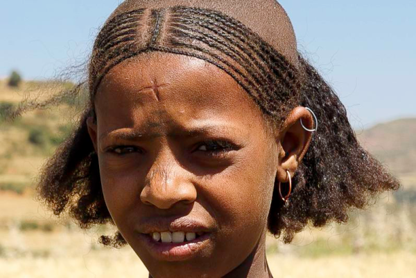 Ethiopia, with a cross branded on her forehead