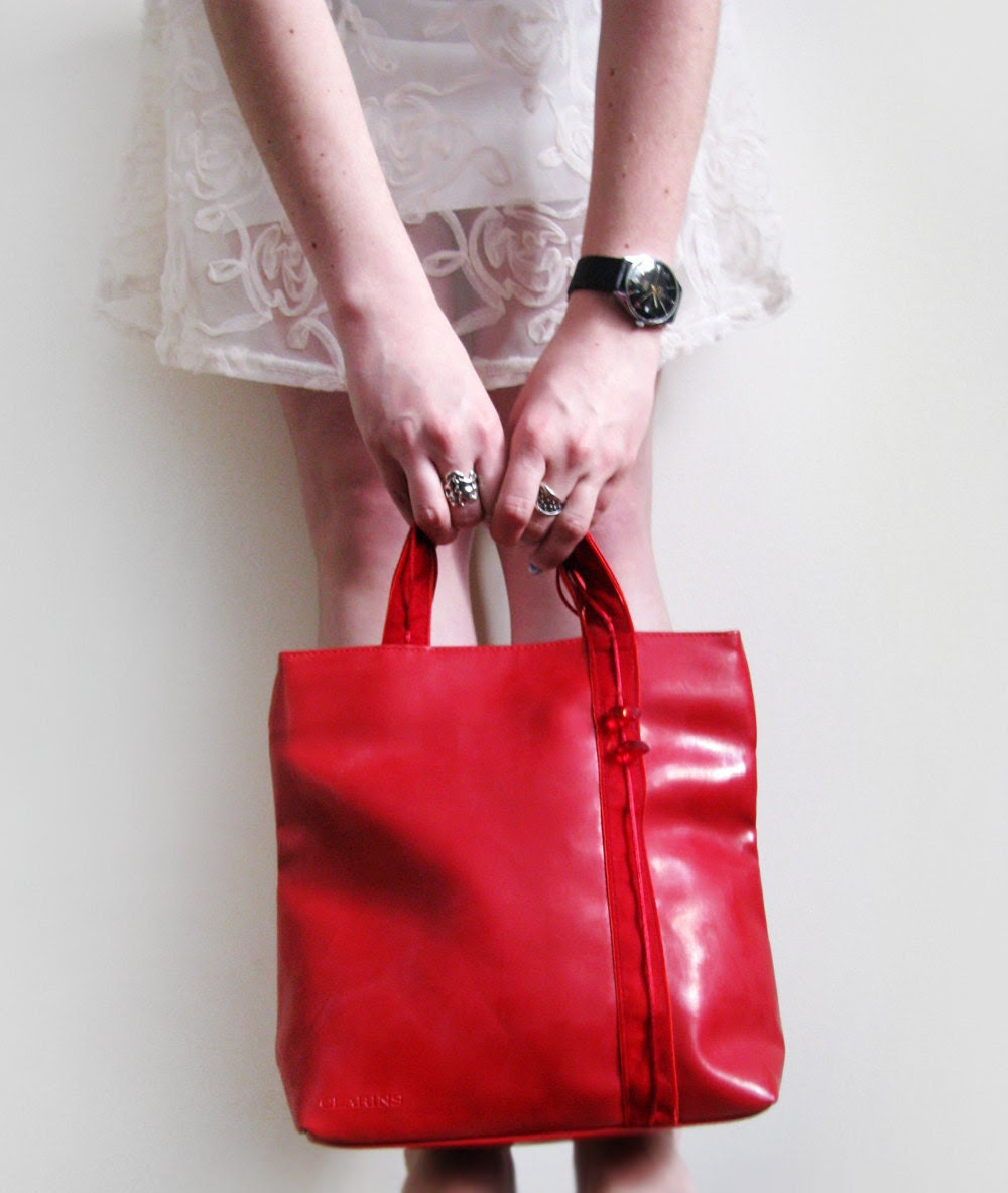 French red handbag with hearts, artificial leather bag - plot
