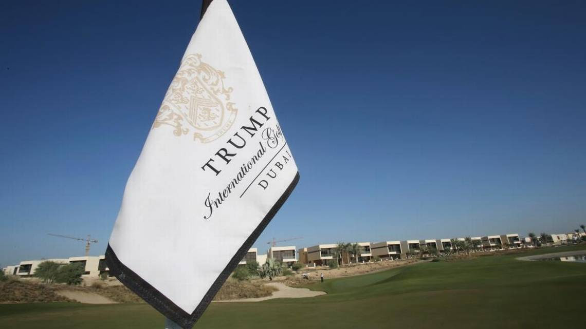 A flag flies in late 2016 on a green lined with villas at the Trump International Golf Club, in Dubai, United Arab Emirates. The 18-hole golf course in Dubai bearing Donald Trump's name exemplifies the questions surrounding his international business interests.