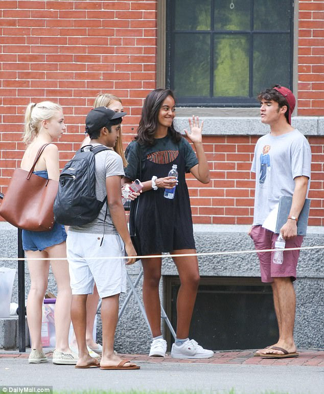 She comes in peace:Malia Obama moved into her new dormitory at Harvard University on Monday afternoon (above on Tuesday outside the dorm)