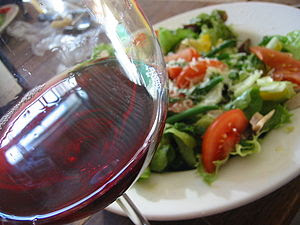 A glass of Beaujolais red wine with salad (Photo Credit Wikipedia)