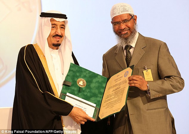 And the winner is... Saudi King Salman bin Abdul Aziz presents Zakir Naik, president of the Islamic Research Foundation in India, with the 2015 King Faisal International Prize for Service to Islam