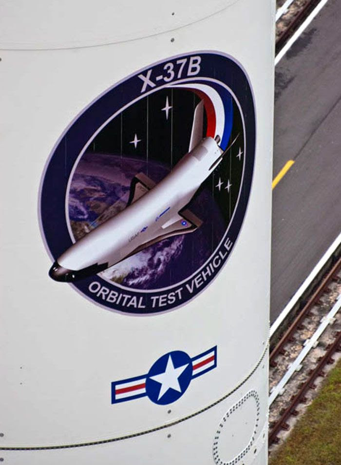 A close-up of the X-37B's mission logo on the side of the Atlas V rocket's payload fairing.