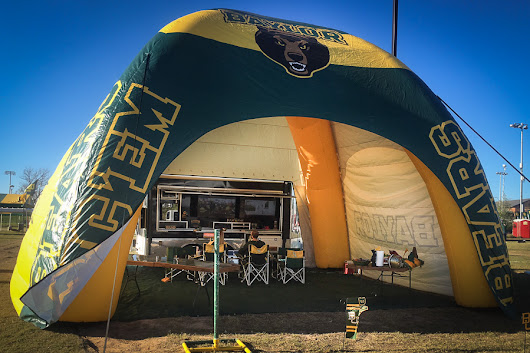 Large, customized inflatable tent provides plenty of space and shade for festive gameday fun.