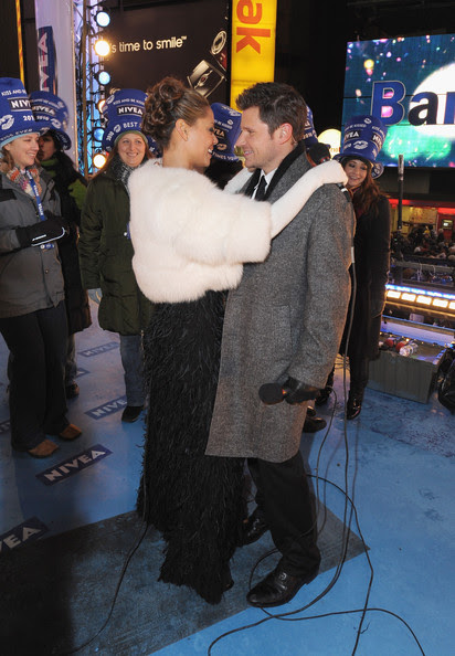 "Musician Nick Lachey and Vanessa Minnillo, co-hosts of the NIVEA Kiss Platform, pose in Times Square on New Year's Eve where they rang in 2010 as a year of ""Love, Hugs and Kisses"" on December 31, 2009 in New York City."