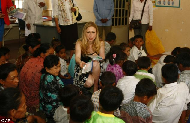 Humanitarian: Chelsea Clinton hands out her donation to children who are affected by HIV/AIDS at a hospital at Neak Loeung town, Cambodia