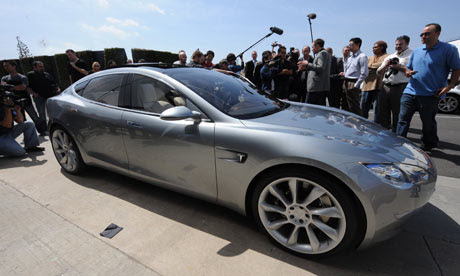 Media gather around the new Tesla Model S all-electric sedan car