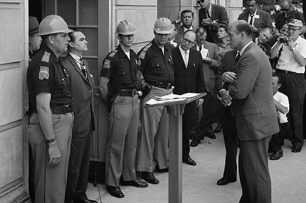 "Former Alabama Gov. George C. Wallace vowed ""segregation forever"" and blocked the door to keep blacks from enrolling at the University of Alabama on June 11, 1963, in Tuscaloosa, Ala, while being confronted by Deputy U.S. Attorney General Nicholas Katzenbach. (File/USN&WR)"