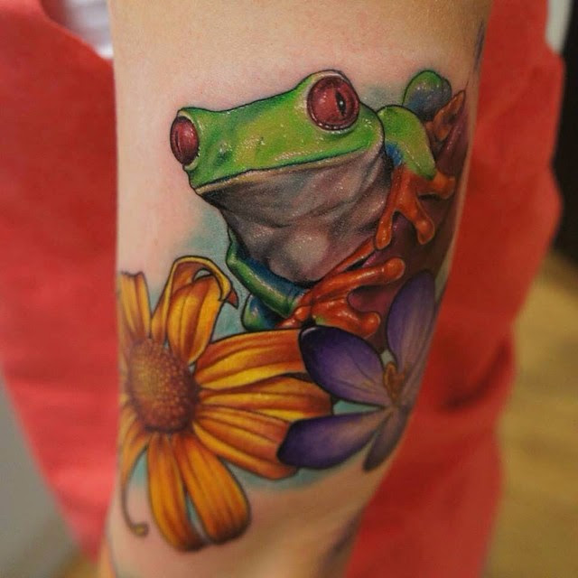 Colored Flowers And Frog Tattoo On Left Bicep