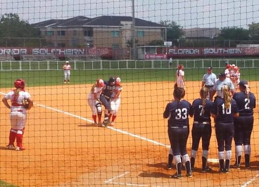 These softball players carried an injured runner from the opposing team around the bases