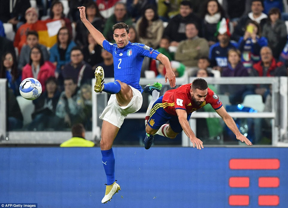 Italy's midfielder Mattia De Sciglio (left) sends Spain and Barcelona full-back Jordi Alba flying