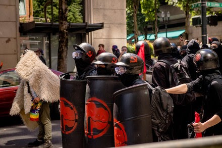 TREND ESSENCE:Trump, Lacking Clear Authority, Says U.S. Will Declare Antifa a Terrorist Group