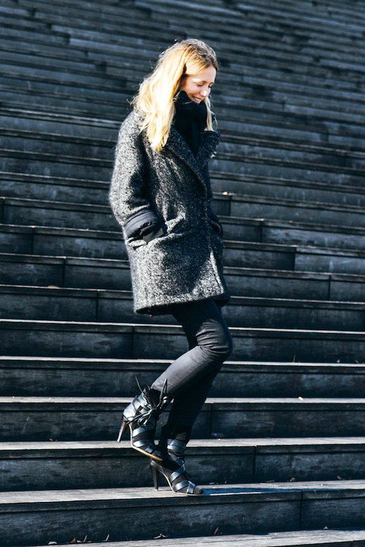 Le Fashion Blog Winter Street Style Jennifer Neyt Chunky Scarf Wool Blend Coat Skinny Jeans Wrap Boots Via Vogue