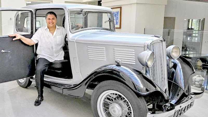 Galle Face Hotel Chairman Sanjeev Gardiner poses with the 1935 Standard Nine vintage car owned by Prince Philip. - AFP