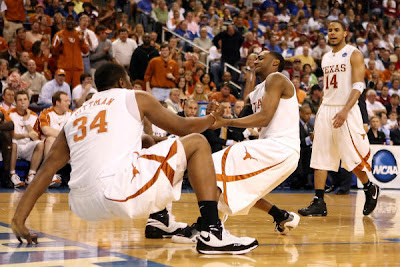 University of Texas Junior Guard A.J. Abrams Strugles To Help Up Teammate Sophmore Center Dexter Pittman