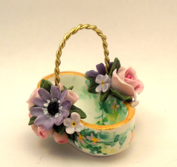 CDHM Artisan Loredana Tonetti works in cold porcelain creating delicate whimsical 1:12 scale flowers, gourd houses, seasonal accessories, dishes, and teapots for the dollhouse miniature collector