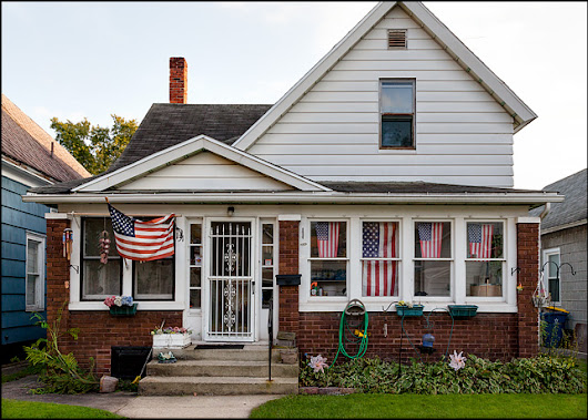 House with five American flags in the front windows | Mishawaka Indiana | Photograph by Christopher Crawford
