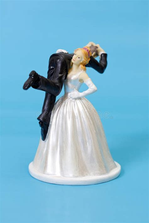 Funny wedding cake topper stock image. Image of bride