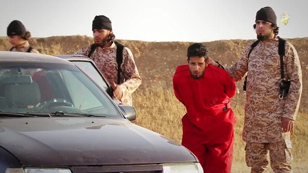Bound: The full seven minute video actually begins by showing a group of men wearing orange jumpsuits being led into a desert clearing. They are then locked in an Opel car, which is destroyed by a grenade launcher