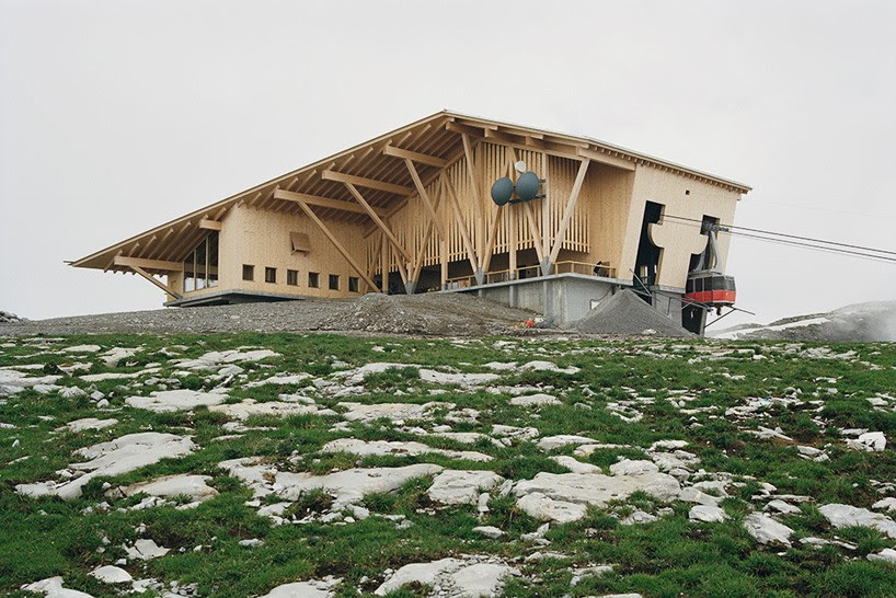 herzog & de meuron's summit building in switzerland contains a mountaintop restaurant
