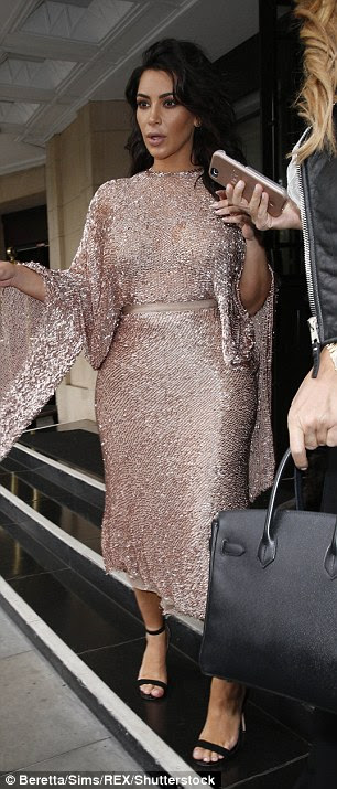 Glamorous as ever: She styled her hair in voluminous, old Hollywood waves and opted for her favourite nude make-up tones