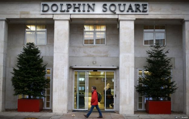 Man walks past front of Dolphin Square