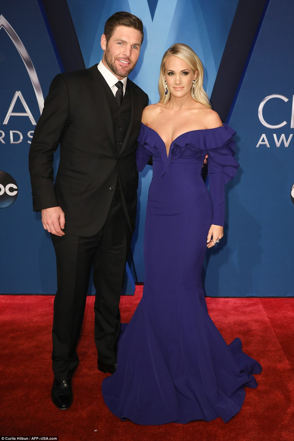 So in love:She was joined on the red carpet by her dashing husband Mike Fisher