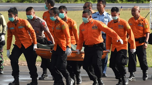 30 bodies, window panel found as AirAsia search focuses on 'most probable' area