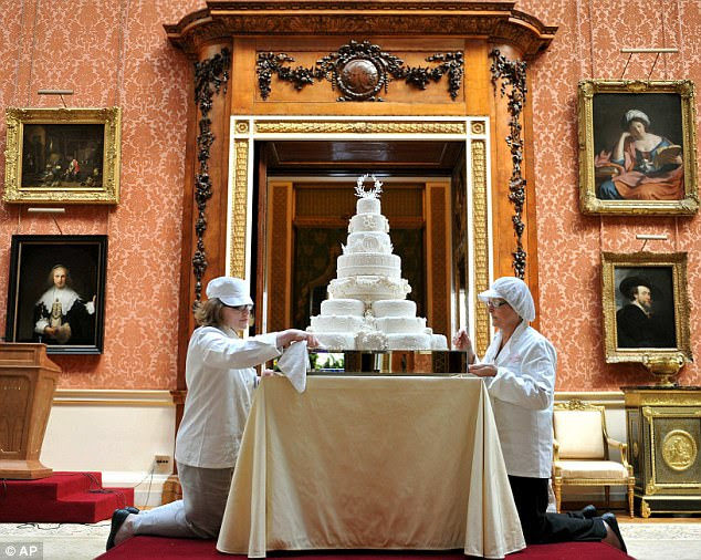 Delicious: Rachel Jane Eardley, left, and Diane Pallett prepare the royal wedding cake in the Picture Gallery of Buckingham Palace