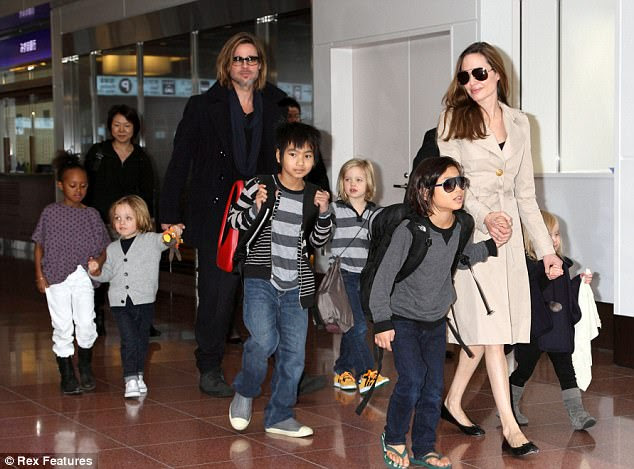 Family: They have six kids together: Maddox, 15; Pax, 13; Shiloh, 11; Zahara, 12; and twins Vivienne and Knox, nine; with Shiloh, Zahara and Pax (pictured in 2011)