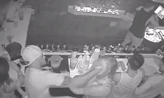 Blow by blow: Johnson then returns the punch, hitting the unidentified woman in the side of the head