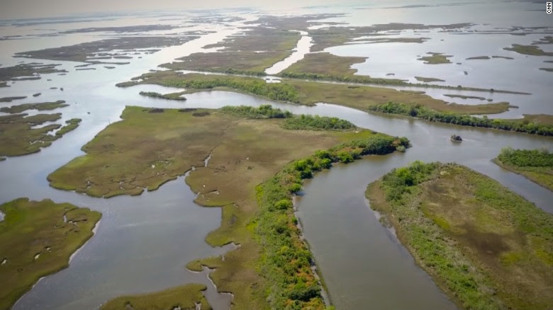 As seas rise, fishermen deny climate change