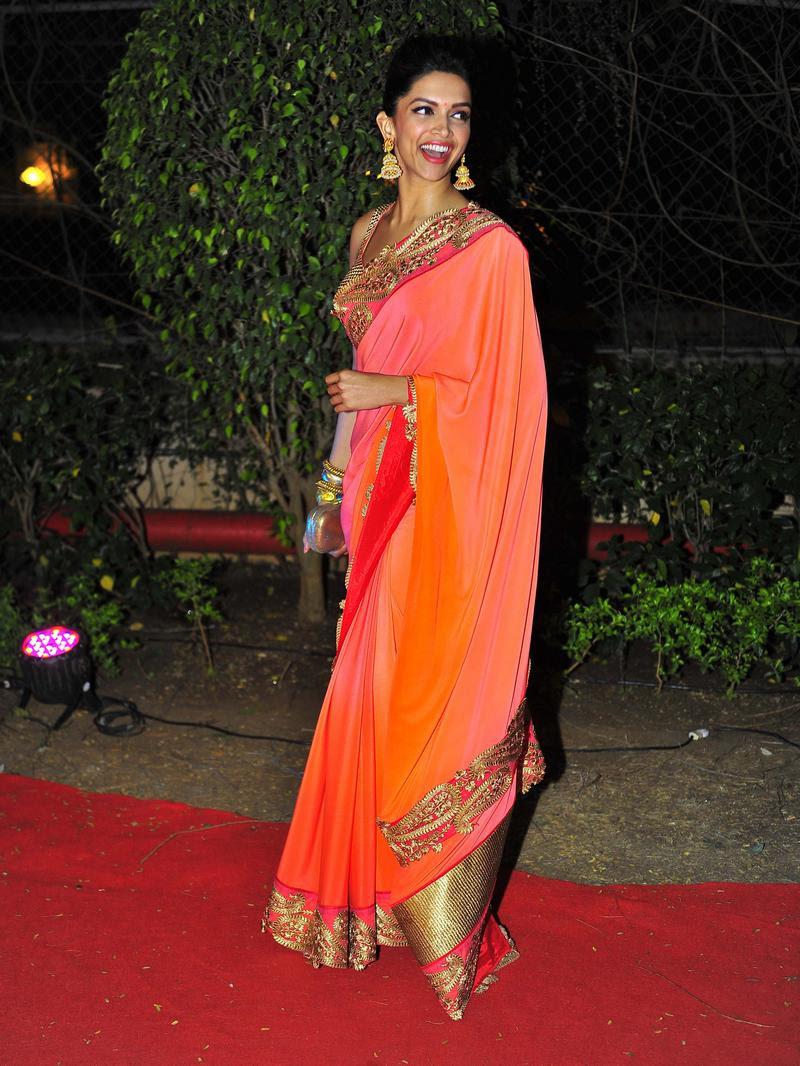 Deepika Padukone in pink saree at a wedding reception ...
