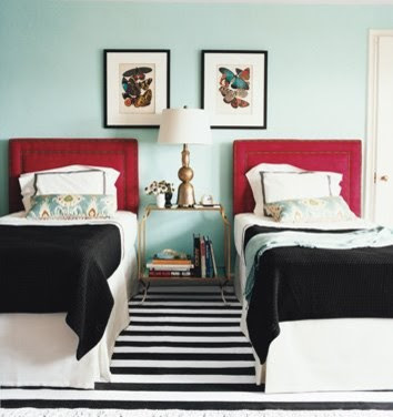 Blue guest bedroom with red accents (Domino via House of Turquoise) contemporary bedroom