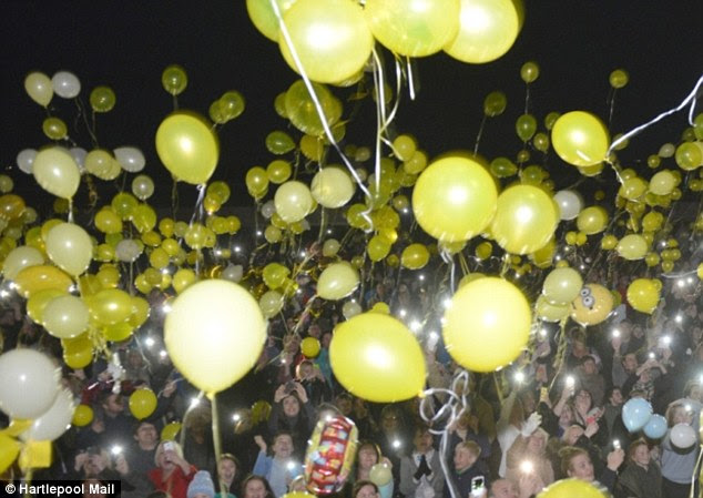 Touching: His death came as hundreds  released yellow balloons in a show of support for the family