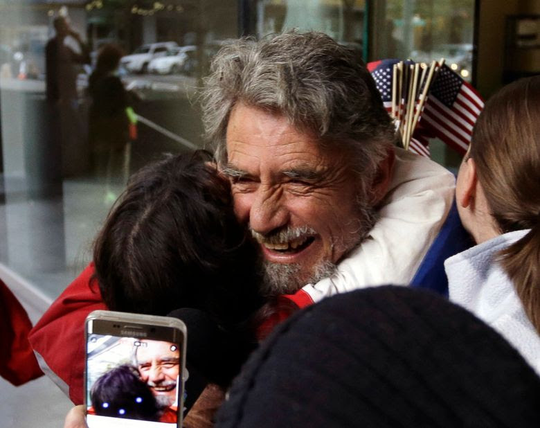 Defendant Neil Wampler is greeted by supporters as he leaves federal court in Portland on Thursday. (Don Ryan / The Associated Press)