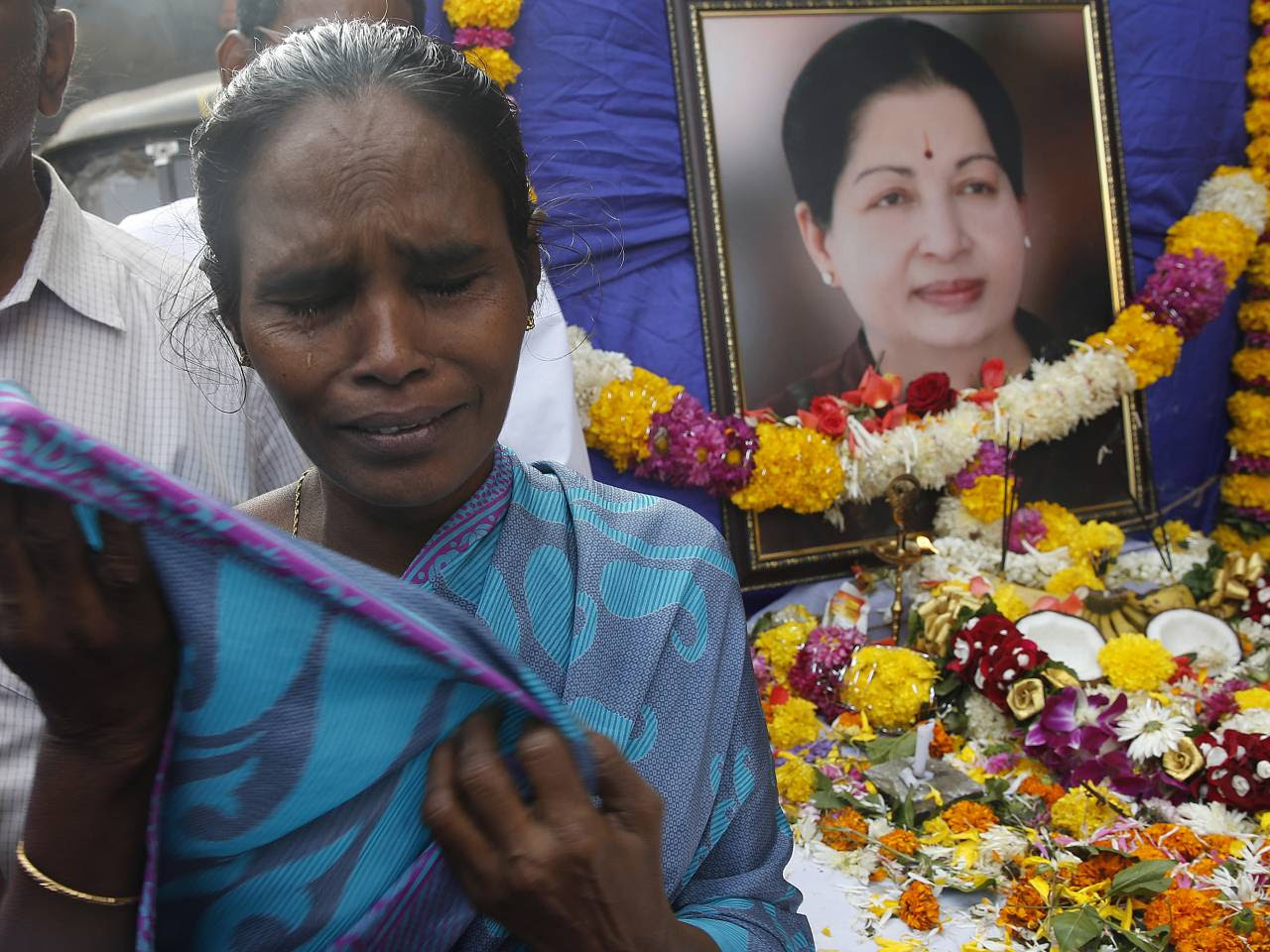 A supporter of India's Tamil Nadu state's former Chief Minister, Jayaram Jayalalithaa, mourns as she pays her tributes after her death outside their party office in Mumbai, India, Tuesday, Dec. 6, 2016. Jayalalithaa, the hugely popular south Indian actress who later turned to politics and became the highest elected official in the state of Tamil Nadu, died Monday. She was 68.