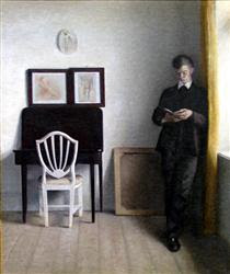 Interior with Young Man Reading - Vilhelm Hammershoi