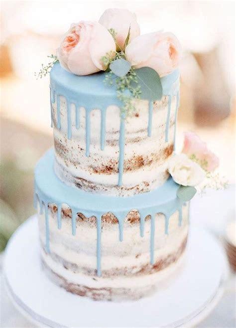 Beautiful semi naked wedding cake decorated with blush