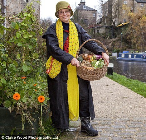 Food for thought: Todmorden resident Estelle Brown, a former interior designer, with a basket of home-grown veg