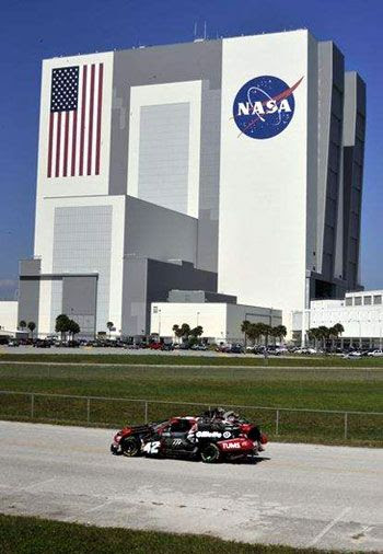 An Autobot 'Wrecker' drives past the Vehicle Assembly Building at NASA's Kennedy Space Center in Florida.