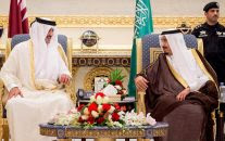 King Salman of Saudi Arabia, right, welcomes Qatar's Emir Sheikh Tamim bin Hamad Al-Thani upon his arrival to Riyadh Airbase before the opening of Gulf Cooperation Council summit in Riyadh, Saudi Arabia, May 5, 2015. (Saudi Press Agency/AP)
