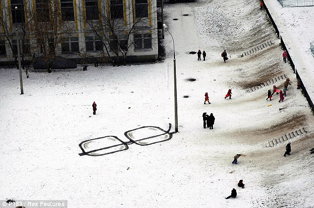 Seeing is believing: Russian guerilla artist P183's eyeglasses project in Moscow inventively uses a lamp-post to double as the arm of a giant pair of glasses, with the rest of the 'frames' drawn in the snow
