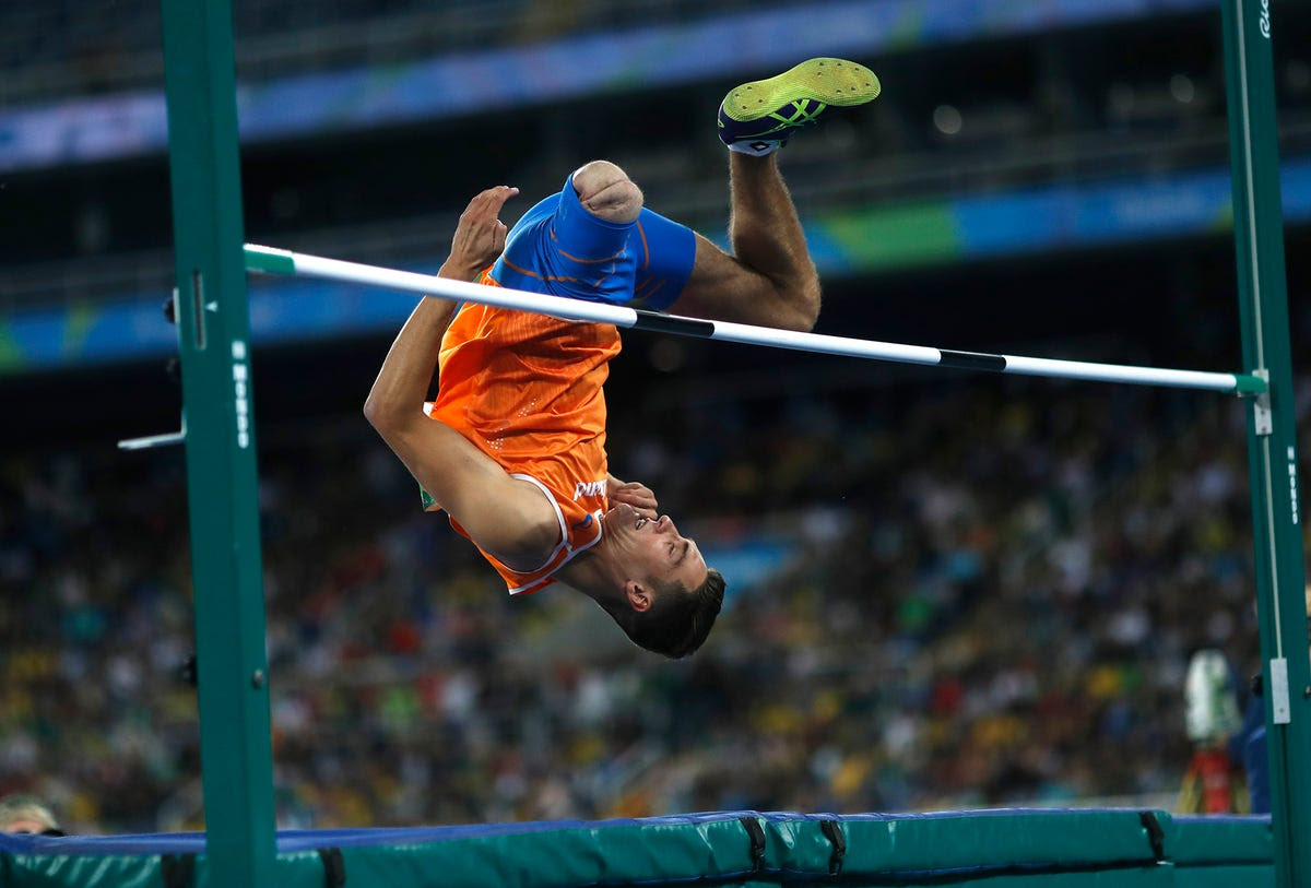 Jeroen Teeuwen of the Netherlands clears the bar in the high jump.
