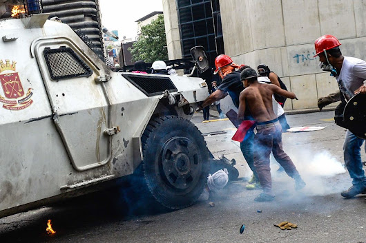 Armored Car Hits Crowd as Venezuela Riots Leave 300 Injured