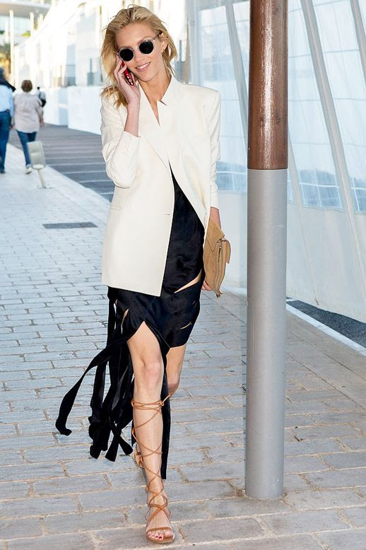 Le Fashion Blog Model Off Duty Style Anja Rubik Round Sunglasses Structured Cream Blazer Black Ribbon Hem Satin Dress Lace Up Gladiator Sandals Suede Clutch Via Vogue