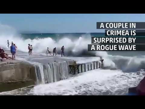A rogue wave knocks several off of their feet in Crimea! Watch the video to know more!