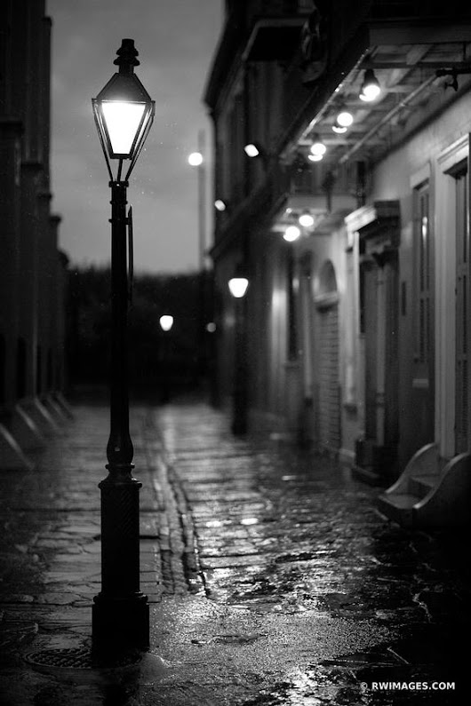 Photo Print of PIRATE'S ALLEY RAINY DAY FRENCH QUARTER NEW ORLEANS BLACK AND WHITE VERTICAL Print Framed Picture Fine Art Photography Large Print Wall Decor Art For Sale Stock Image Photo Photograph High Resolution Digital Download Aluminum Metal Acrylic Canvas Framed Photo Print Buy Photo by Robert Wojtowicz Fine Art Photographer